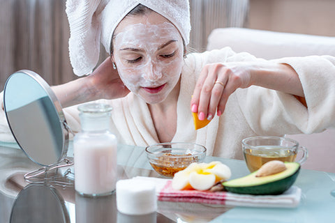 Woman at home doing a DIY face mask