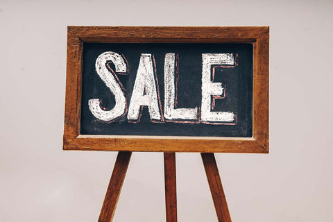 Wooden sign with the word SALE