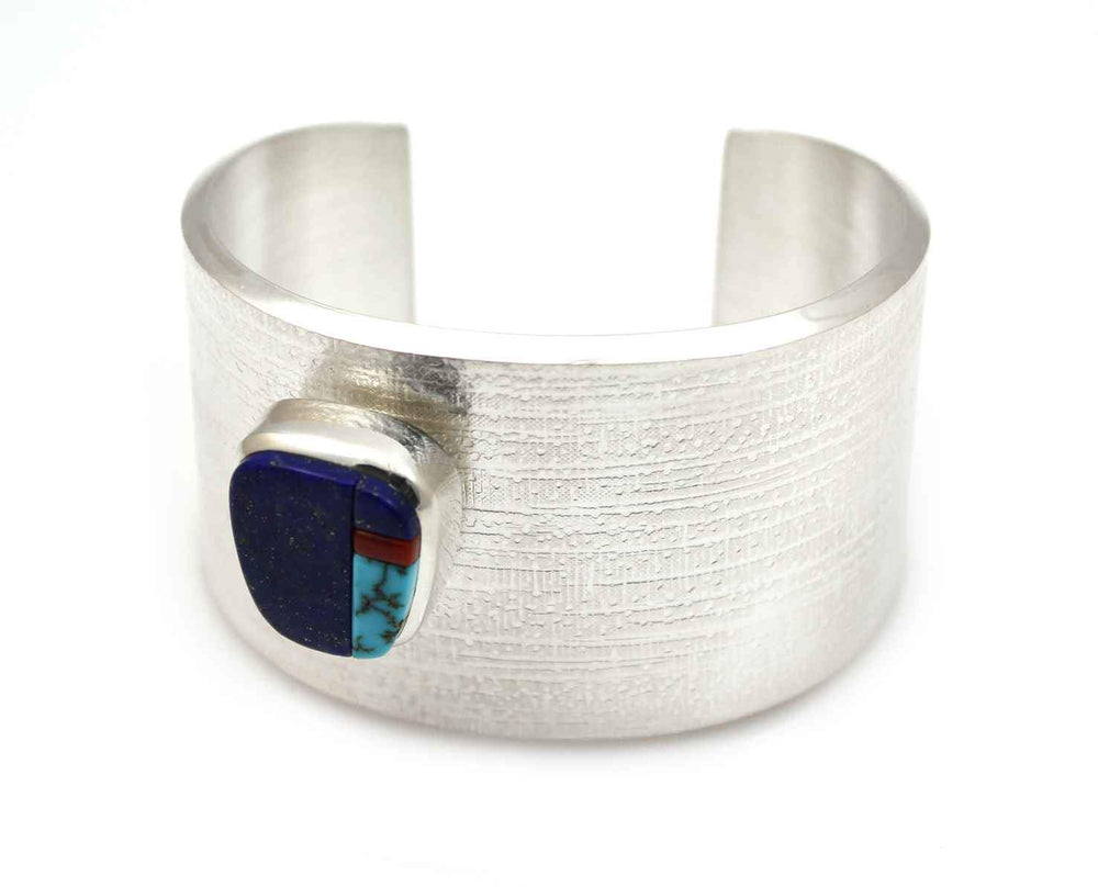 "Sterling silver with lapis, coral and Lone Mnt turquoise. 1 1/2"" wide, size 6"