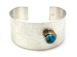 "Sterling silver with 18K gold bezel and natural Lone Mnt turquoise stone, 1 1/2"" wide, size 6 1/2"