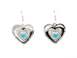 Silver heart earrings with single turquoise stone and french hooks. Don Lucas, Sorrel Sky Gallery