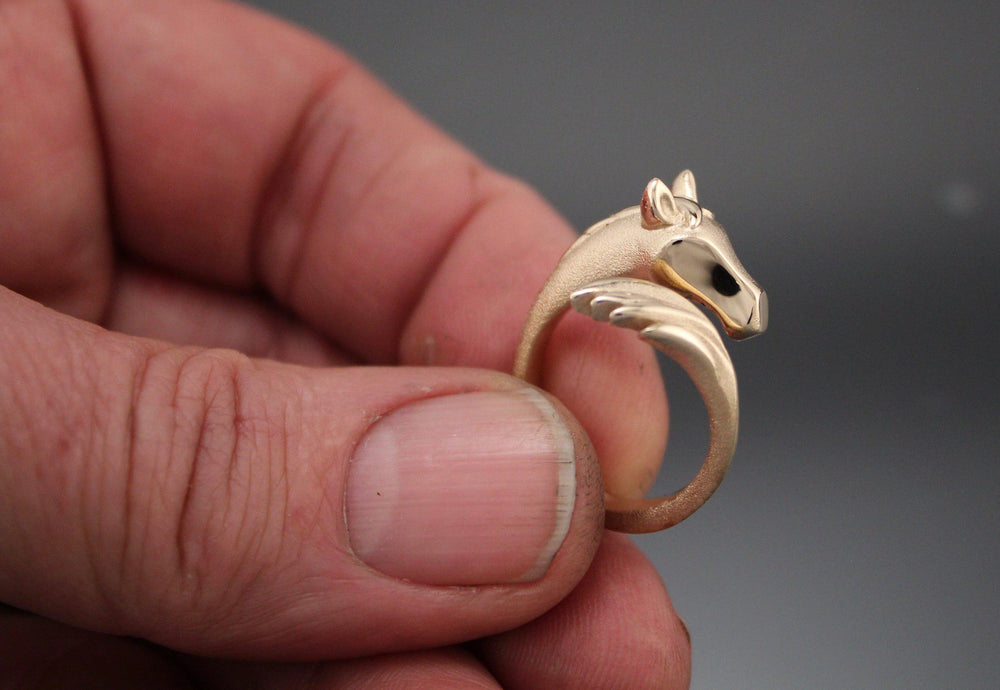 Horse Ring. Head and Tail meet at the top of your finger. Gold Horse Ring. Bronze Horse Ring. Silver Horse Ring. Michael Tatom Jewelry. Sorrel Sky Gallery. Sorrel Sky Jewelry.