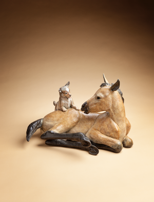 Bronze sculpture of a lying down foal and it's puppy friend