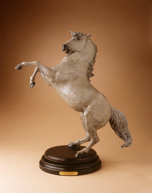 Bronze sculpture of rearing stallion on wooden base