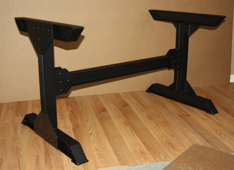 Steel I beam table base with rivets