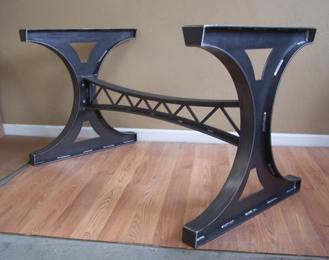 Custom steel trestle table base with 3 added top rails in waxed raw steel