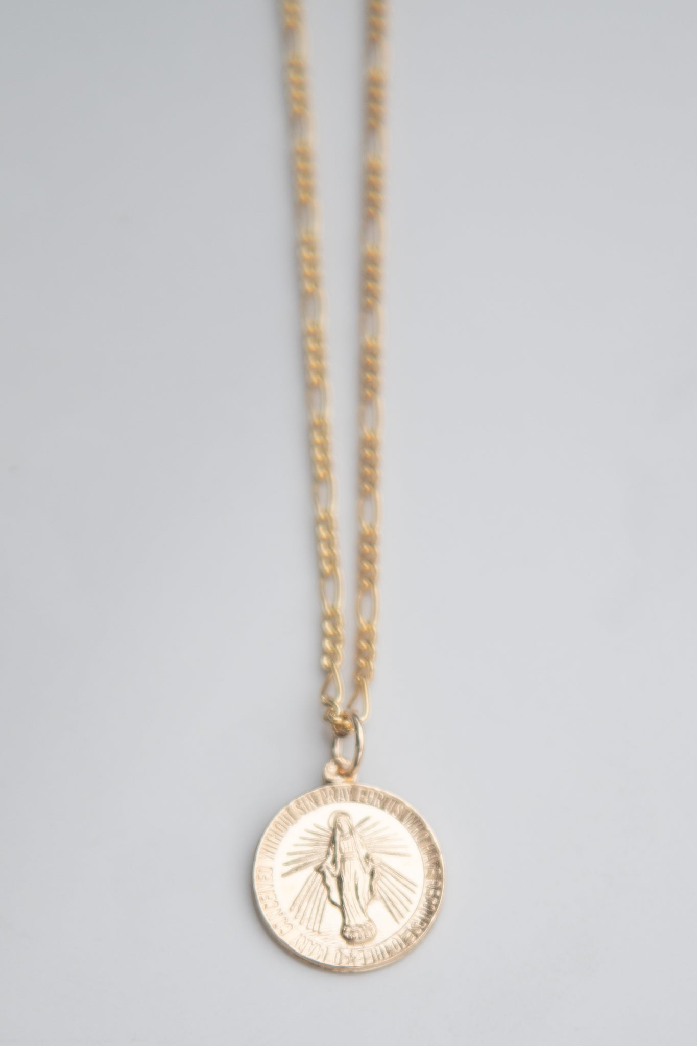 Virgin Mary round medallion