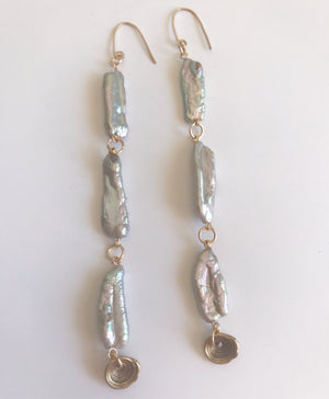 Sirena long drop earrings with Puka shell
