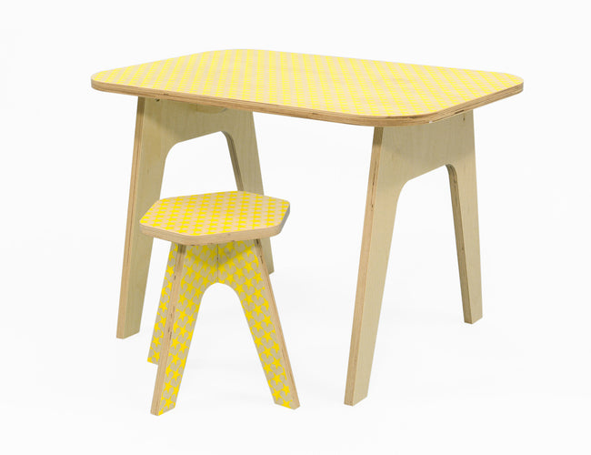wooden kids table with silkscreen printed yellow stars on it. stable sturdy and of high quality. studio delle alpi design
