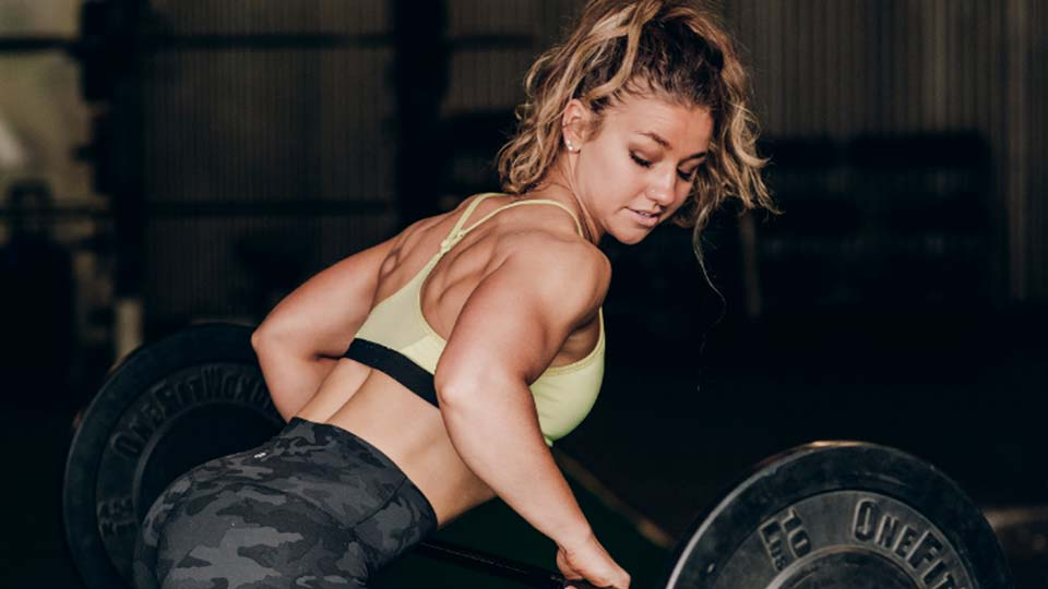 Woman doing bent over rows