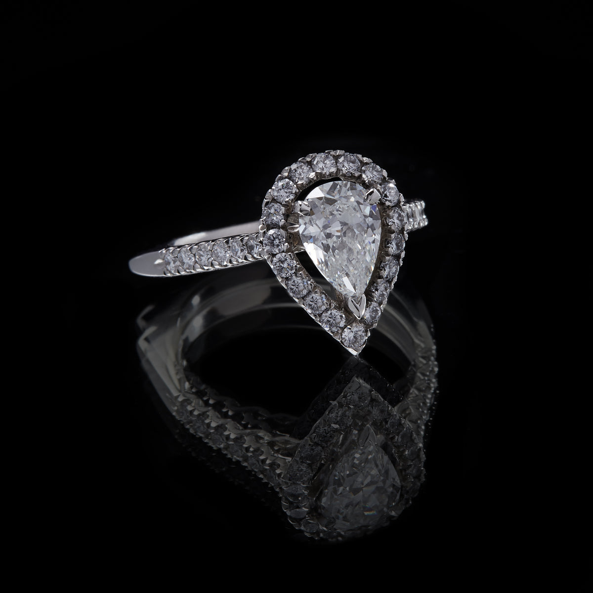 Picture of Platinum Pearshape Diamond Ring with Round Brilliant Cut Diamond Cluster and  Shoulders, low three quarter view