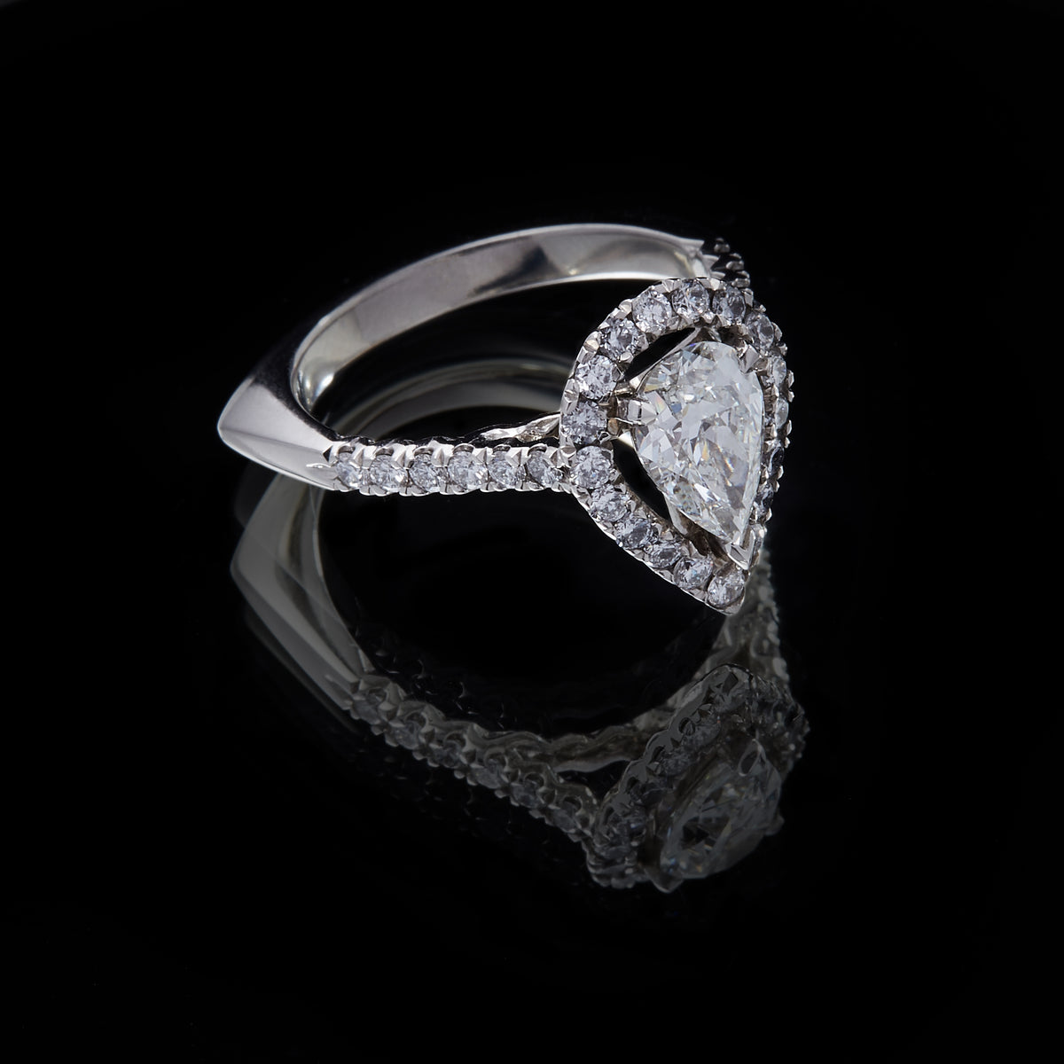 Picture of Platinum Pearshape Diamond Ring with Round Brilliant Cut Diamond Cluster and  Shoulders, three quarter view