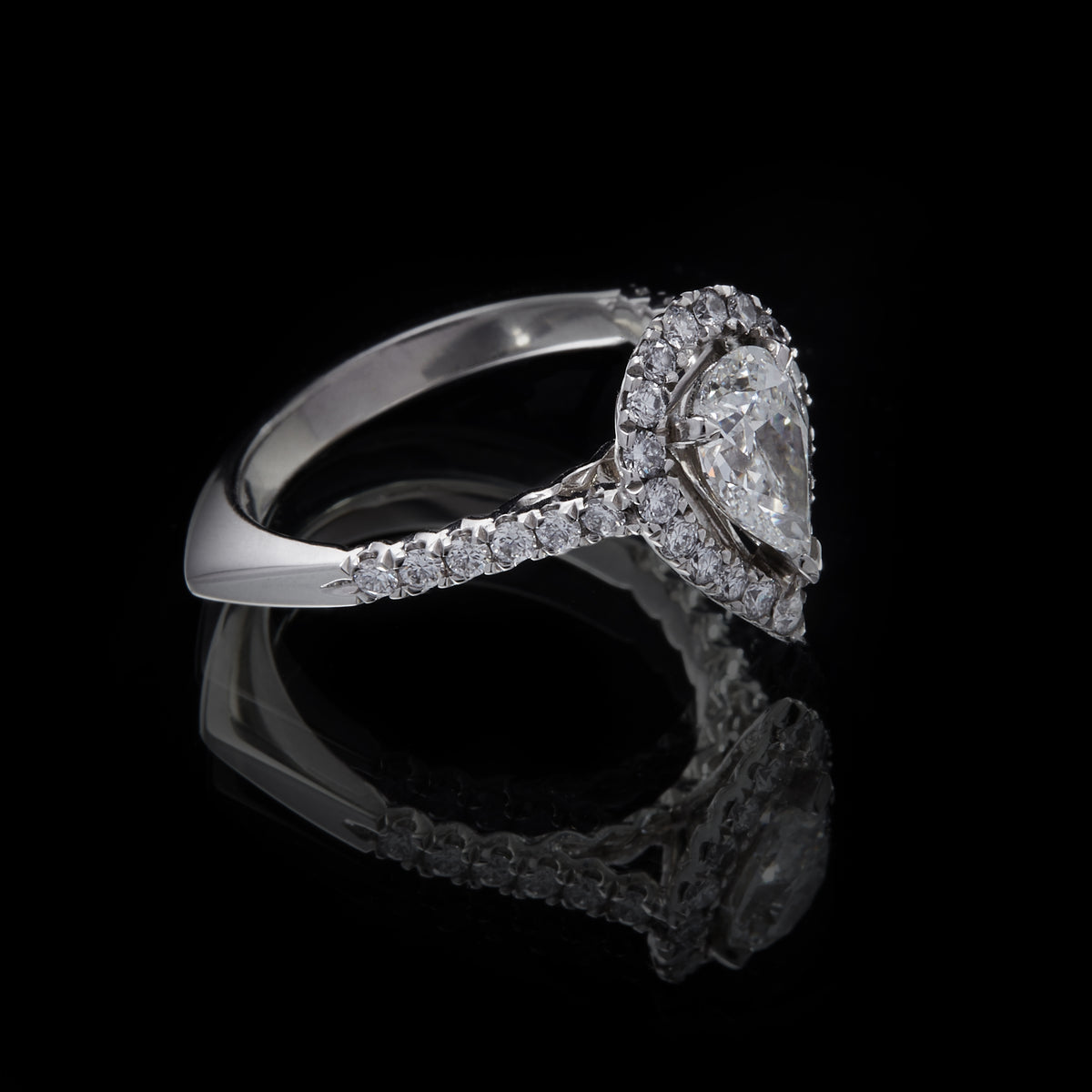 Picture of Platinum Pearshape Diamond Ring with Round Brilliant Cut Diamond Cluster and  Shoulders, side view