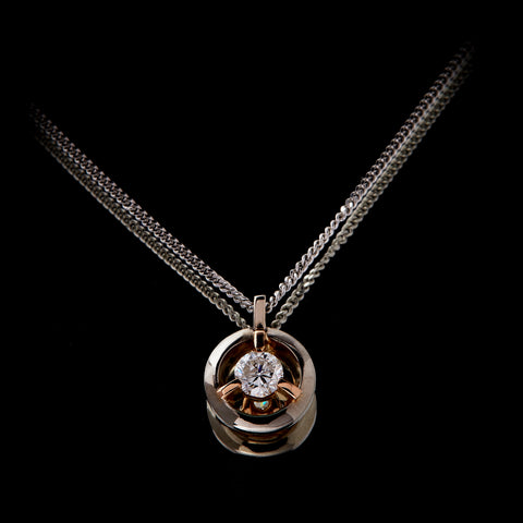 Guy and Max Orbit Three Claw Loop Pendant with 0.22 carat Round Brilliant Cut Diamond suspended in the centre, head on view