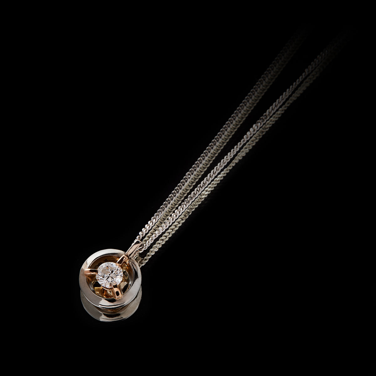 Guy and Max Orbit Three Claw Loop Pendant with 0.22 carat Round Brilliant Cut Diamond suspended in the centre, three quarter view