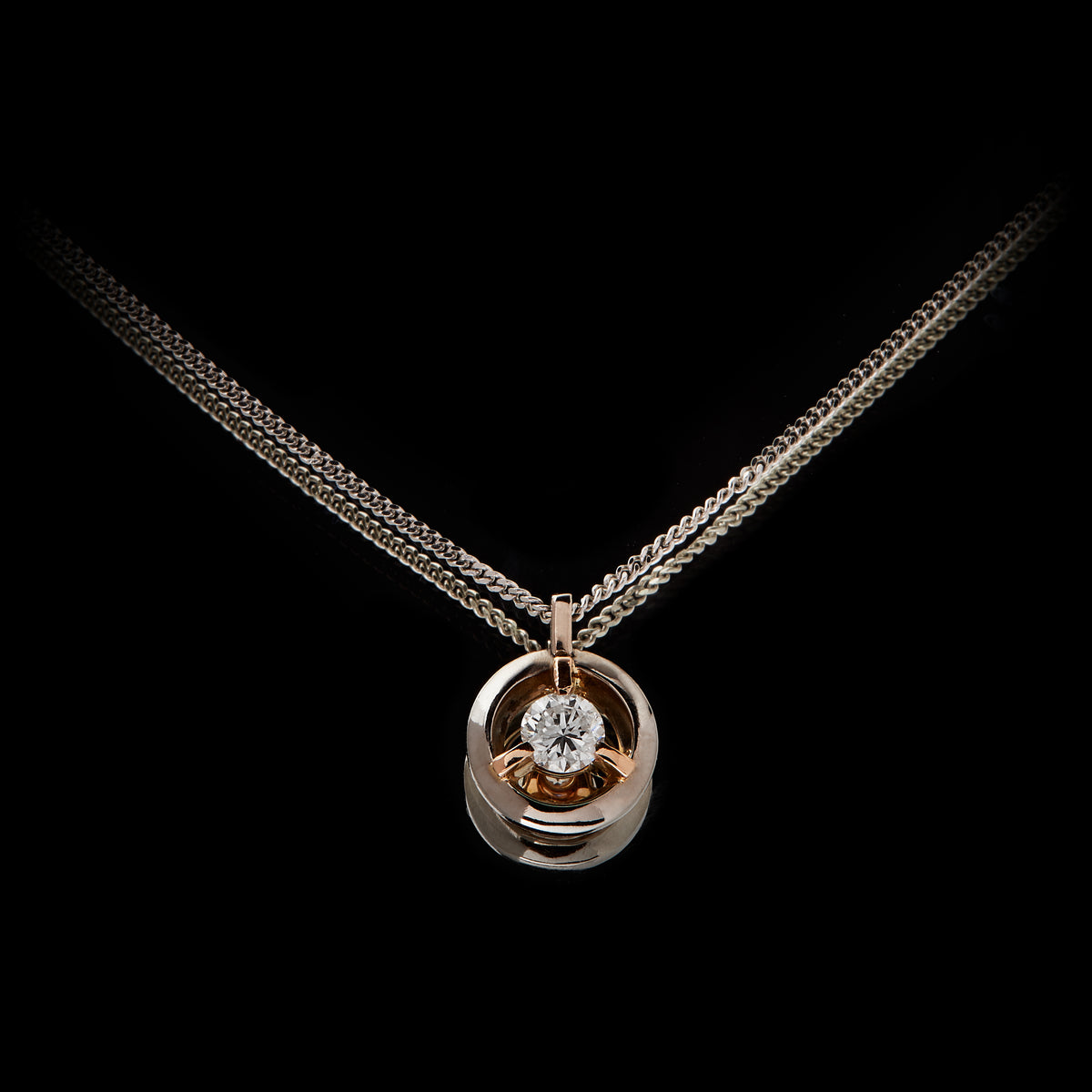 Guy and Max Orbit Three Claw Loop Pendant with 0.22 carat Round Brilliant Cut Diamond suspended in the centre, main view