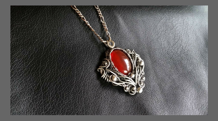 Handcrafted pendants in sterling silver by Kristine Schroeder Studio
