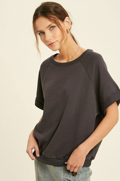 French Terry Raglan Top charcoal front | MILK MONEY milkmoney.co | A super loose fit trendy tops for women top featuring a fold cuff at sleeves and neck line, banded bottom.