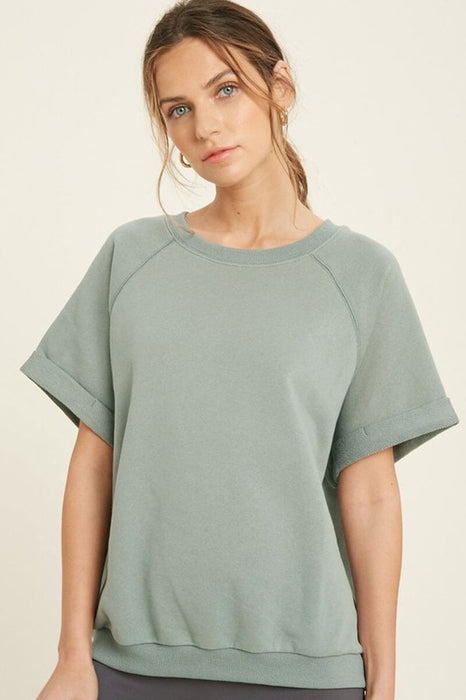 French Terry Raglan Top sage front | MILK MONEY milkmoney.co | A super loose fit trendy tops for women top featuring a fold cuff at sleeves and neck line, banded bottom.