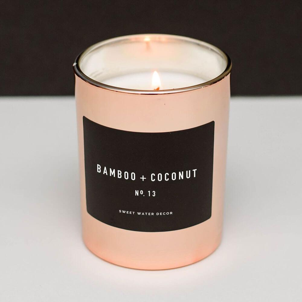 Sweet Water Decor Bamboo Coconut Soy Candle rose gold lit MILK MONEY