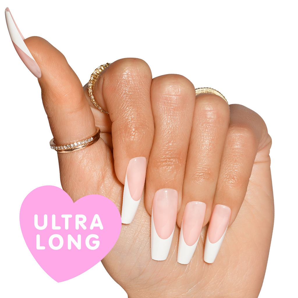Hand wearing Porn Star nails, natural french tip, in coffin shape ultra long length with ultra long bubble