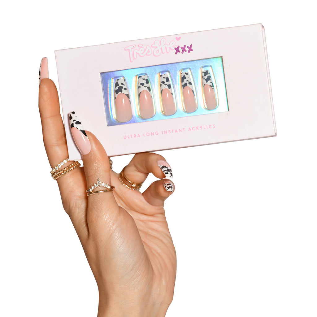 Hand wearing Big Moood nails holding pink product box with Big Moood nails coffin shape ultra long length inside