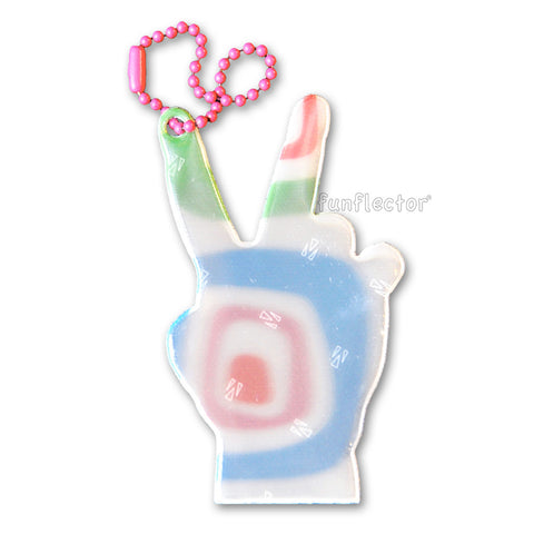 A safety reflector for hanging on jackets, bags and backpacks that looks like a hand doing the peace sign. Multicolored with a colorful ball chain.