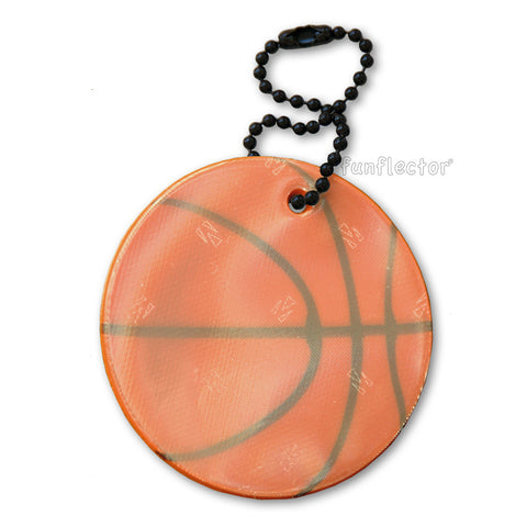 Basketball safety reflector on a steel ball chain for backpacks and jackets.