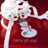 Snowman funflector reflector can be added to gift wrap as a little-something-extra.