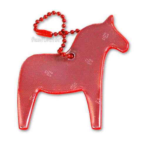 Red Dala horse pedestrian safety reflector for backpacks and jackets.
