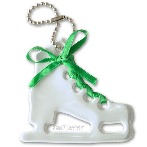 White figure skate pedestrian safety reflector with emerald green satin lace and a steel ball chain.