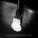 Owl safety reflector by funflector on black purse.