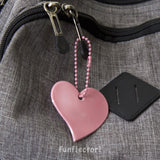 pink heart safety reflector on backpack