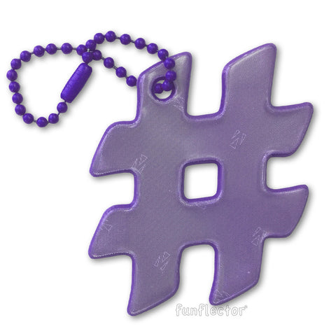 Purple hashtag pedestrian safety reflector for clothing, backpacks and bags.