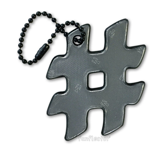 Black hashtag safety reflector for backpacks and bags.