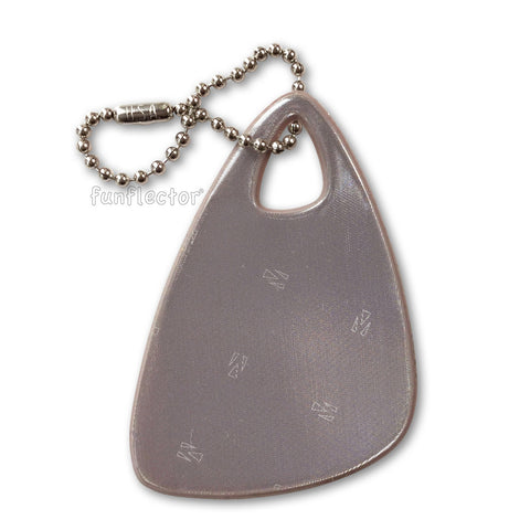 Stylish, modern triangular safety reflector for backpacks and bags in sandalwood.