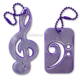 Purple treble and bass  clef safety reflectors for backpacks, bags and jackets.