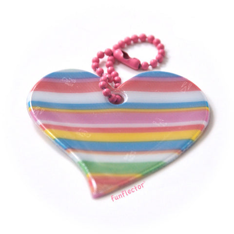 Striped pink rainbow heart safety reflector for jackets and backpacks