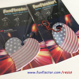 Safety Reflectors with American Flag motiv, with packaging showing how to use them