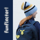 yellow heart and moose safety reflector on backpack