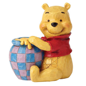 Winnie the Pooh with Honey Pot Mini Figurine - Disney Traditions from thetraditionalgiftshop.com
