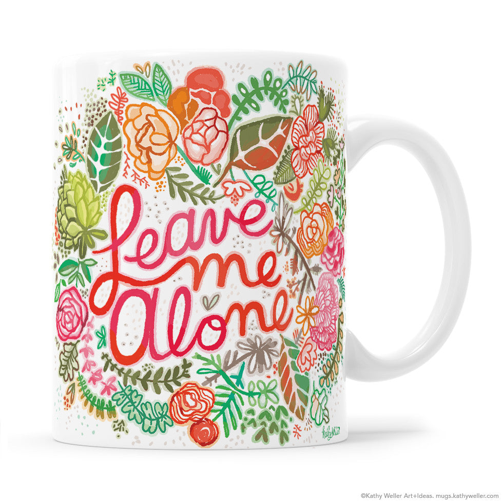 "Tell the world to leave you alone in the most kind way possible with the ""Leave Me Alone"" mug in Blue/Green, featuring hand lettering and a gorgeous floral border design."