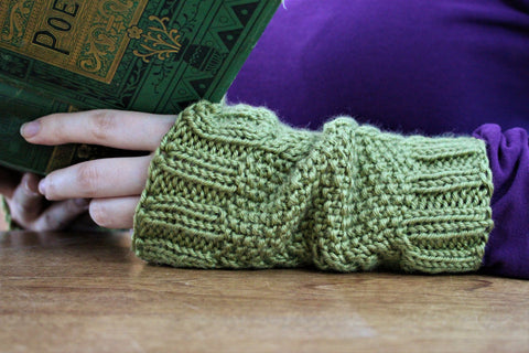 Green arm warmer, hand knit, with cables and seed stitch