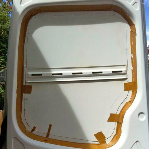 Almost finished cutting window opening in Sprinter van rear door
