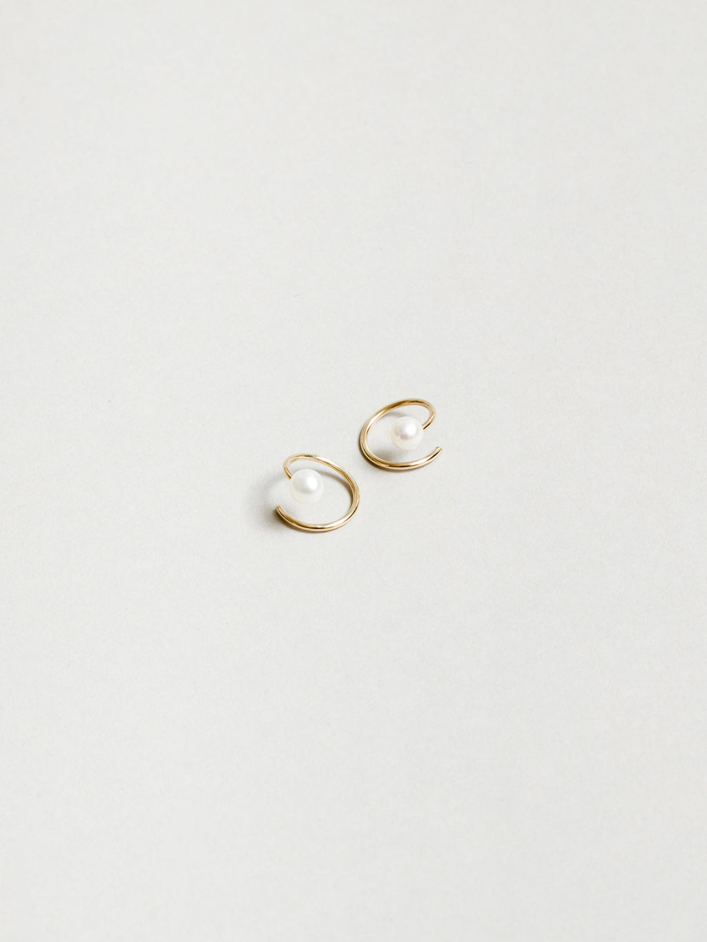 White Pearl Swirl Earrings in Gold