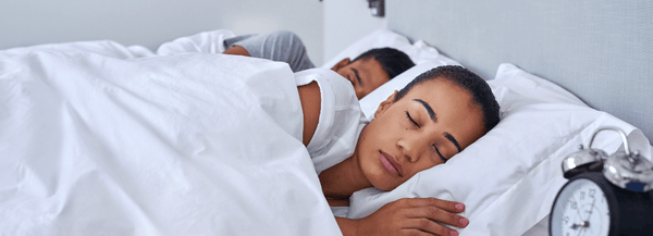couple sharing weighted blanket