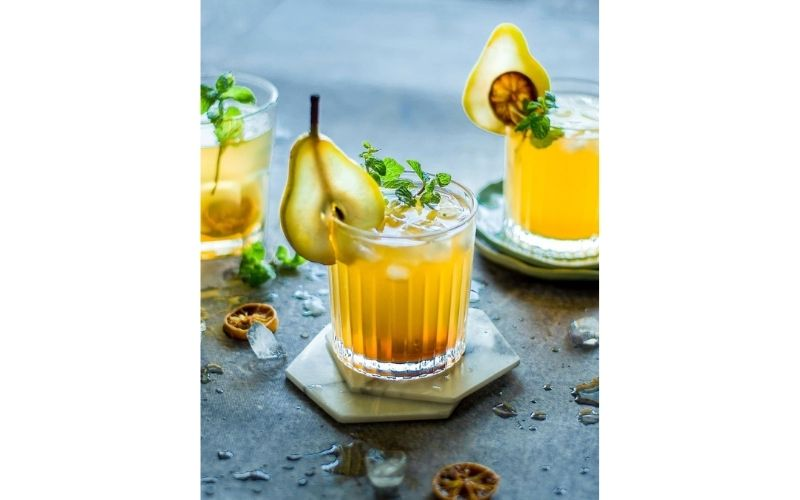 A glass of Honey Pear Whiskey