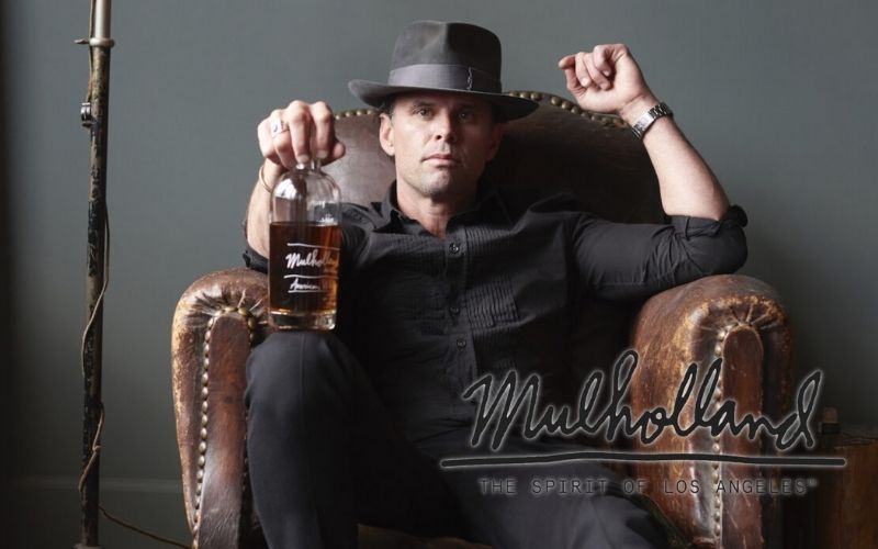 Goggins posing with a bottle of Mulholland Whiskey - Image by whiskyadvocate.com