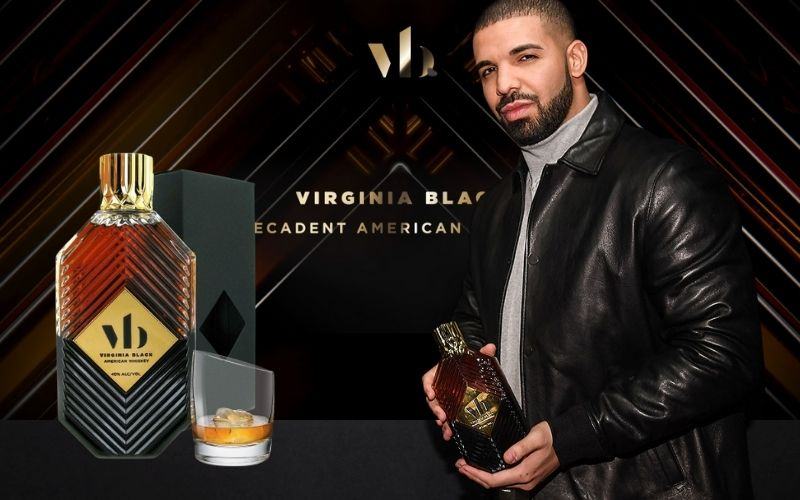 Drake posing with a bottle of Virginia Black whiskey - Image by billboard.com