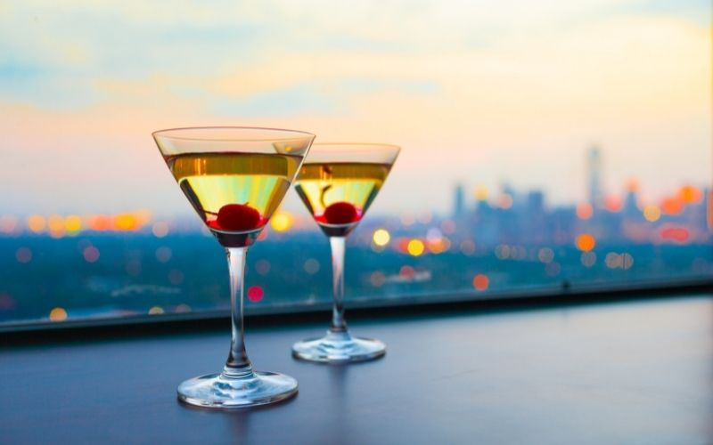 2 Glasses of cocktail with maraschino cherry